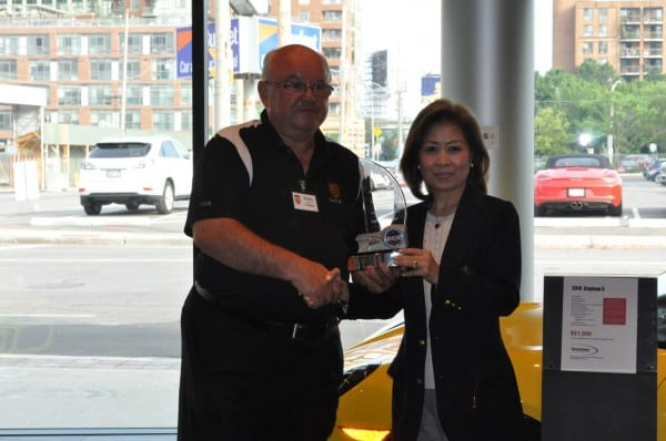 Walter Murray presents Helen Ching-Kircher with UCR's PCA trophy for  the region with the most membership growth in 2012