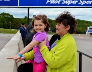 Little Chelsea, coming to the end of her treatment in a few months enjoying watching her friends race around the track and eagerly waiting her turn with Jill Clements-Baartman.