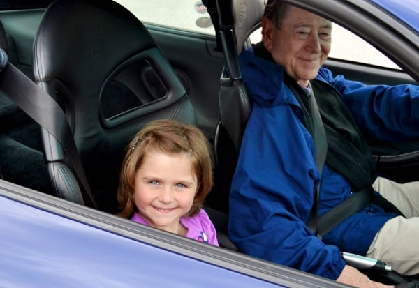 David Forbes enjoys driving Hearth Place participant Chelsea around the track in his Porsche as much as Chelsea enjoys the ride!